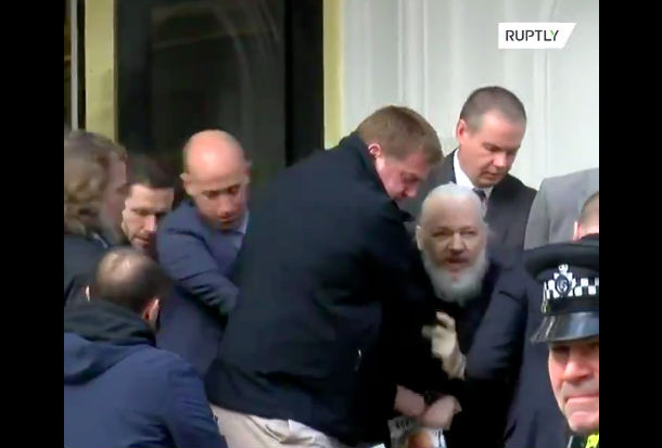 The scene outside the embassy as Assange was dragged into custody.